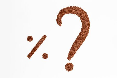 food questions: Question mark and the percentage of buckwheat on a white sheet.