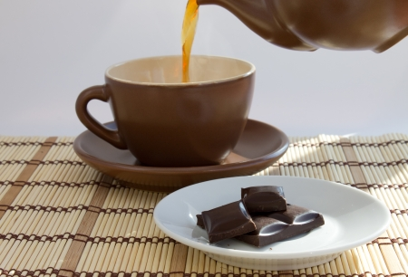pouring tea with a chocolate Stock Photo