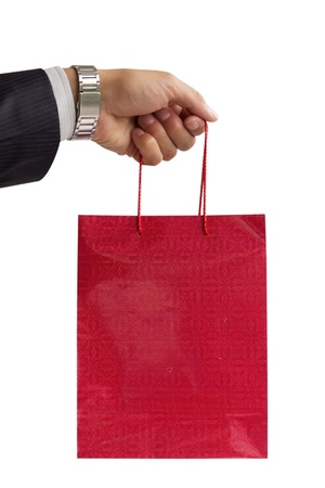 businessman holding red gift bag  Isolated on white Stock Photo - 14532902