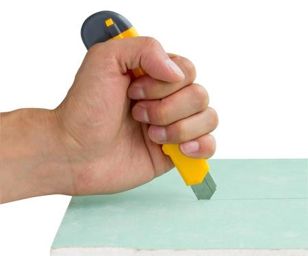 plasterboard: builder cutting plasterboard