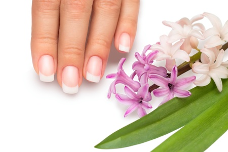 Professional manicure with spring flowers isolatedon white background