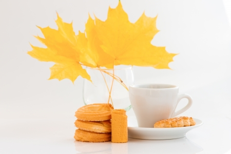 Coffee cup with cookies and autumn leaves on white background Stock Photo - 15830306