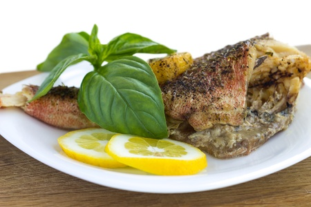 Baked fish with lemon and basil photo
