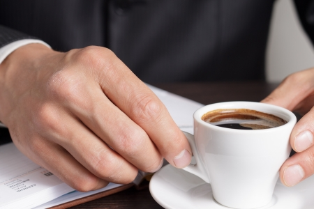 Businessman makes coffee break after work with diary Stock Photo - 19575432
