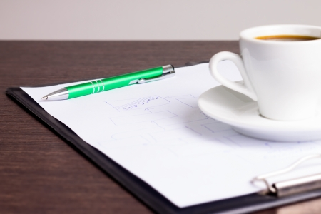 Workplace of businessman. Notes and cup of coffe photo