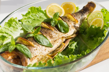 Baked Salmon with Lemon, Salad and Basil cooked in Glass Roaster