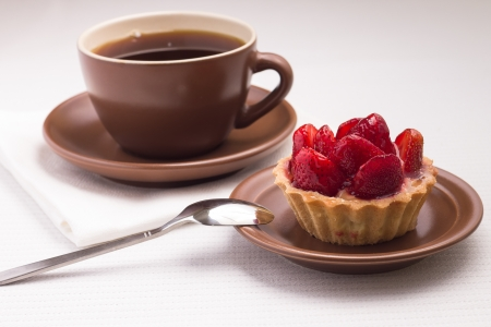Cup of Tea on White Napkin with Sweety Strawberry dessert photo