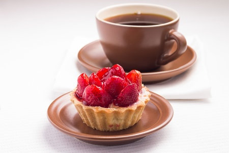 Strawberry dessert in Waffle Basket with Cup of Hot Tea photo