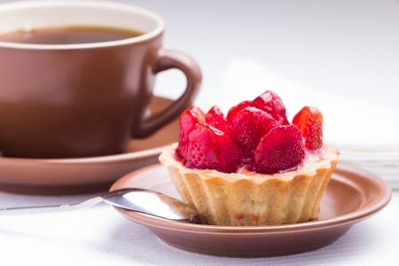 Strawberry dessert in Waffle Basket with Cup of Hot Tea Stock Photo
