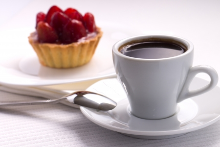 Whie Cup of Black Coffee with Strawberry Dessert in a Waffle Basket