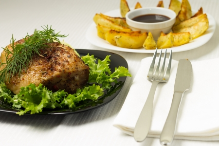 grilled potato: Baked Pork Meat served with Grilled Potato and sauce Stock Photo