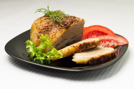 Baked Sliced Meat on Black Dish