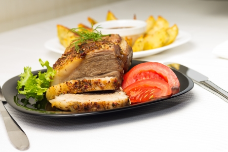 grilled potato: Baked Meat with Grilled Potato and Tomato on Served White table Stock Photo