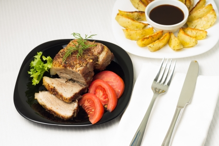 grilled potato: Top View on Baked Pork Meat served with Grilled Potato and sauce