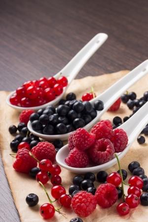 Fresh berries in ceramic spoons