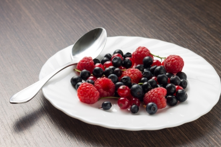 Frsh Berries in White Saucer with Spoon photo