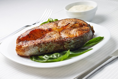 Served Table with Grilled Salmon Steak. photo