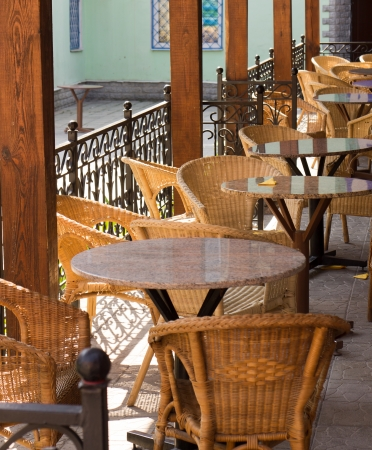 Empty Street cafe with wicker chairs photo