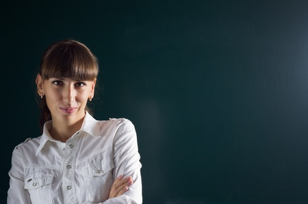 Young attractive woman near school blackboard photo