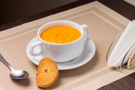 Pumpkin soup in white bowl with crouton Stock Photo