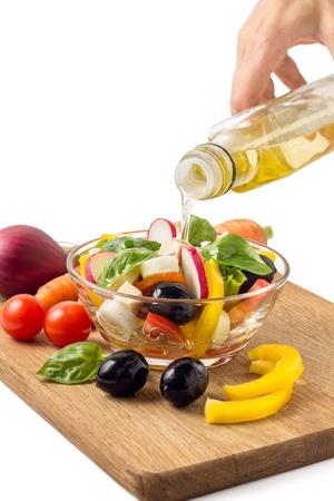Preparing greek salad with olive oil