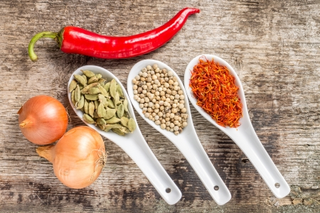 Background with Spices and Vegetables on wood plank Stock Photo