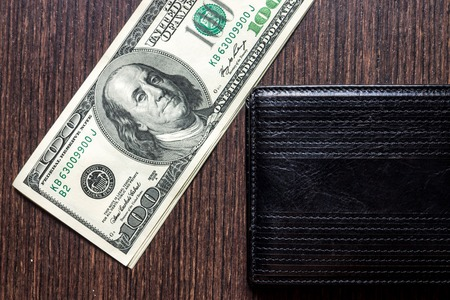 money with leather wallet on table. Top view photo
