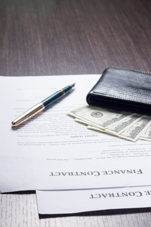 Financial document with wallet, money and fountain pen photo