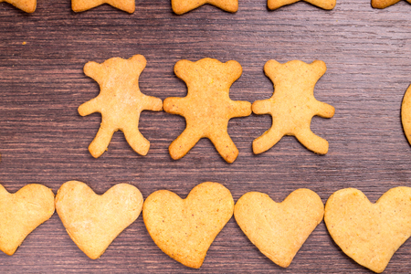 gingerbread cookies bear in dance with hearts
