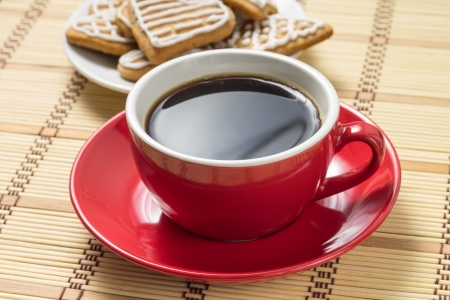 Cup of coffee with gingerbread cookies photo