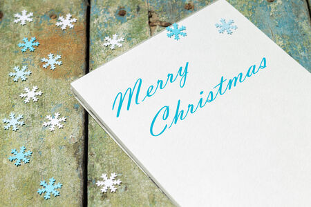 Christmas greeting card with snowflakes on grunge background photo