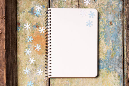 Christmas background with empty notepad on wood photo