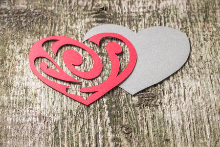 Red Ornament Paper Heart wih Paper Shadow on wood background
