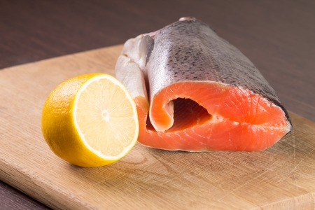 Fresh Raw Salmon or Trout with Lemon on wood
