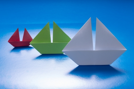 Group of Paper Ships Sailing on Blue paper sea  Origami Boat  Paper Sea photo
