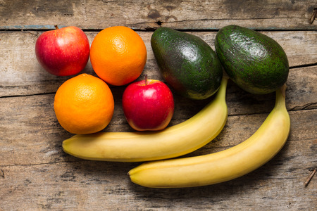 Various Fruits on wooden Background photo