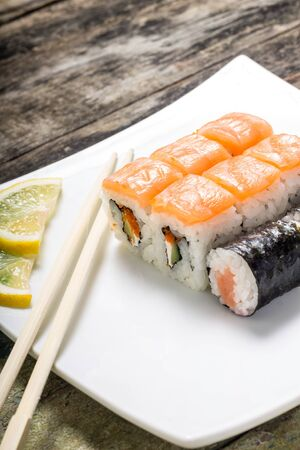Seafood sushi rolls in white plate with chopsticks and japanese spices Stok Fotoğraf