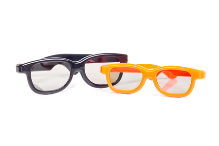 Two pairs of 3-d cinema glasses isolated on white background photo