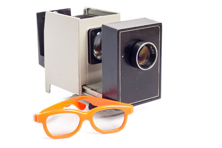 3 d glasses: Pair of 3-d cinema glasses and slide projector isolated on white background Stock Photo