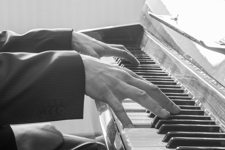 Mans hands playing the Piano. Black and White photo