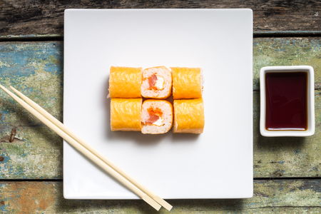 philadelphia roll: Seafood sushi rolls on weathered wood background. Top View