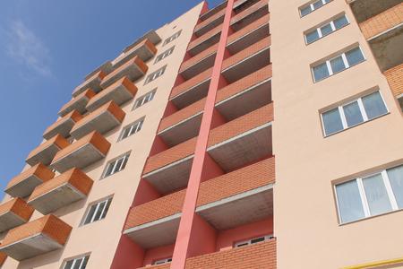 Apartment building on a blue sky photo