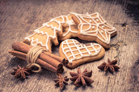 toned image: Christmas gingerbread cookies on wood background. Toned image