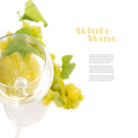 sauvignon blanc: Glass with white wine and cluster of grapes isolated on white background with copyspace. Top view