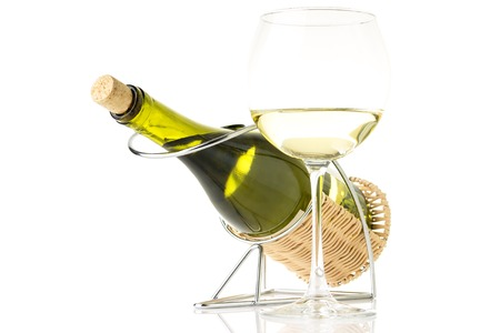 sauvignon blanc: Bottle in holder with glass of shardonnay wine isolated on white background