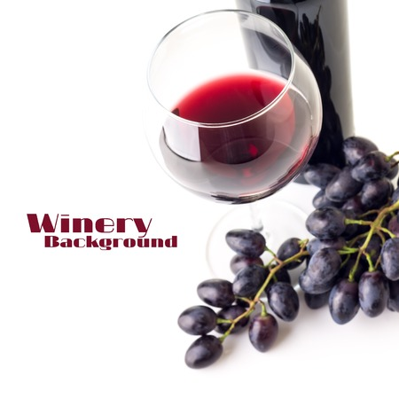 glass bottles: Glass of red wine with bunch of grapes  and bottle isolated on white background. Selective focus