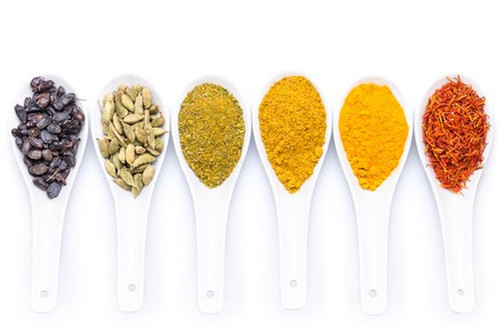 Diverse of spices in ceramic spoon isolated on white background