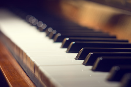 Keyboard of piano. Selective focus image. Warm color toned music background 스톡 콘텐츠