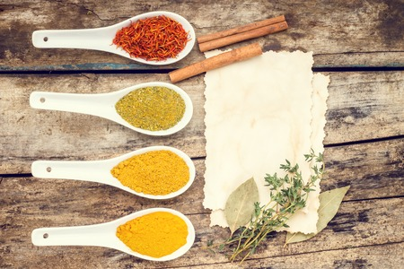 recipe background: Vintage Spices recipe background. Various condiments with branch of thyme. Top View Stock Photo