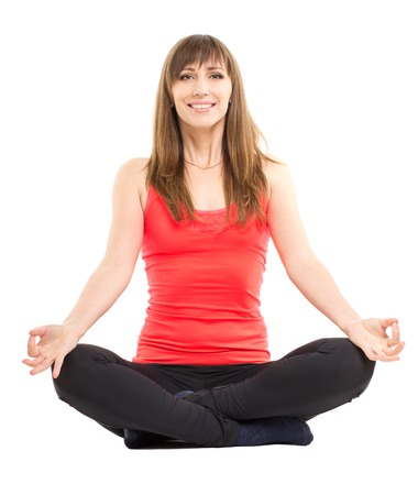 female pose: Young smiling fitness woman doing yoga exercises isolated on white background.